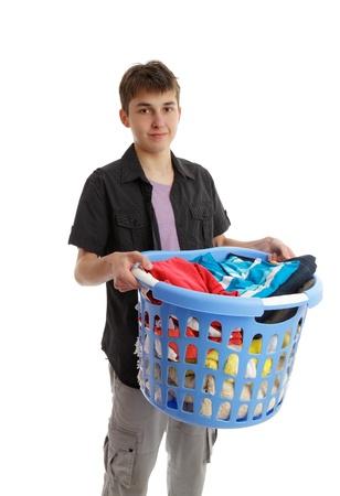 man laundry: Boy with a basket full of washing or ironing.