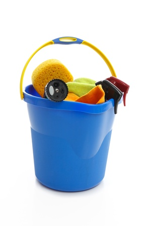 A bucket holding car cleaning products.