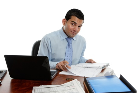 Businessman at desk with laptop computer photo