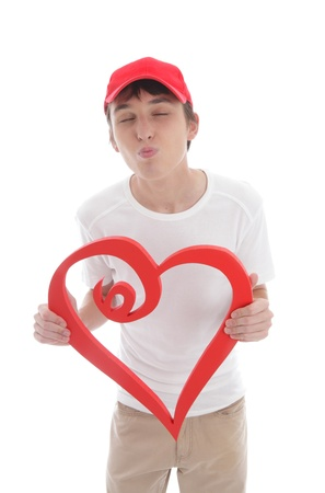 smooching: Teen boy with red love heart kissing, puckering up.  White background.