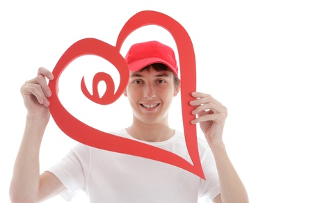 A teenager looking through a red love heart and smiling photo