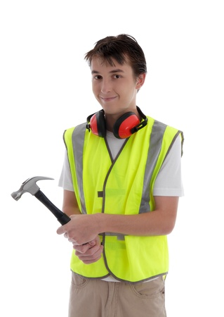 Teenager holding a hammer and smiling.  White background. Stock Photo - 17569436