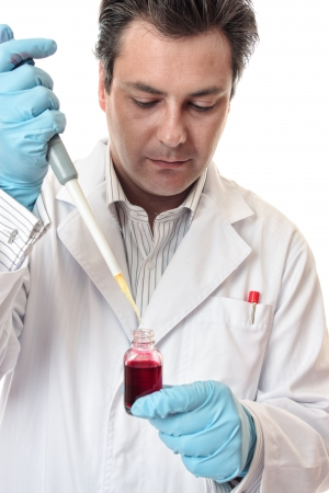 Amale  scientist using a pipette for accuracy. photo