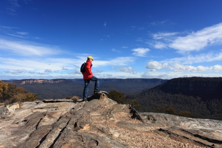 admires: A bushwalker admires the views from Flat Rock Wentworth Falls, Blue Mountains Australia