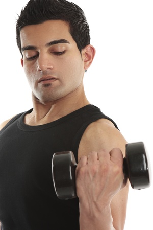 A man works his biceps triceps using a hand held weight photo