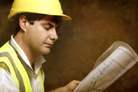Foreman, project manager or a builder with architectural site plans photo