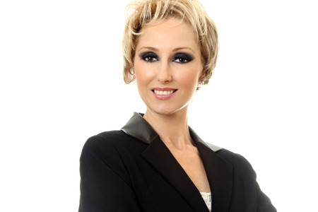 smartly: Female businesswoman smartly dressed wearing a black jacket and smiling   White background