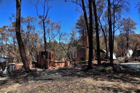 decimated: Houses caught up in bushfires have been razed to the ground, while others were spared  Stock Photo