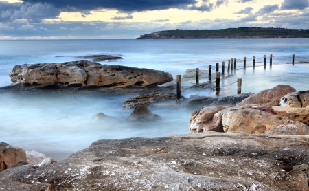 swells: Idyllic Mahon rock pool, Maroubra, near Sydney Australia at early dawn, that is filled by surging tidal swells from the Tasman Sea