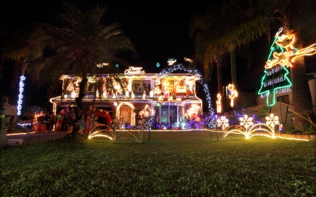 Toowoon Bay, Australia - December 10, 2013; House decorated with a variety of Christmas lights and decorations for the festive season  Editorial