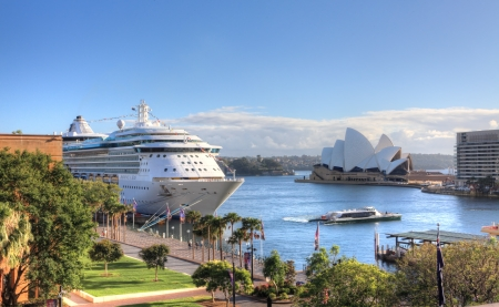 disembark: Sydney, Australia - December 1, 2013;  Royal Carribean Cruise Liner, Radiance of the Seas docked at Circular Quay in Sydney    Sydney Opera House in background   This ship boasts floor to ceiling windows and an outdoor cinema playing first run movies