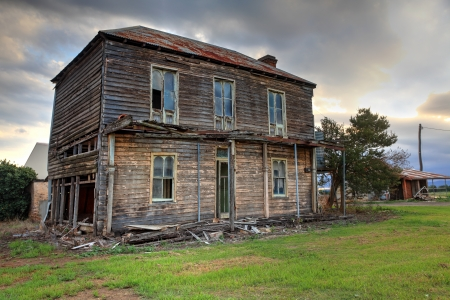 A dilapidated two storey late Victorian Georgian farm house with corrugated iron roof with attic space and corbelled brick fireplace,  no longer lived in   It once had an upper storey verandah with fancy wrought iron lattice work   It lies between the Haw photo