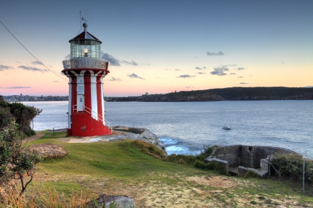 searchlight: The beautiful red and white Hornby Lighthouse on South Head, Sydney Australia, the entrance to Sydney Harbour, at dawn. Editorial