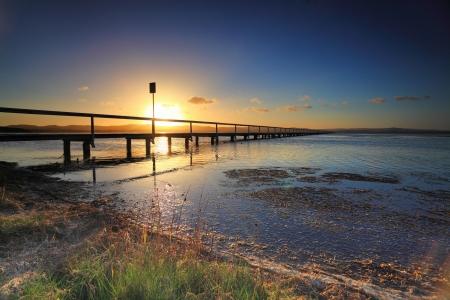 nsw: Sun setting at Long Jetty, NSW, Australia