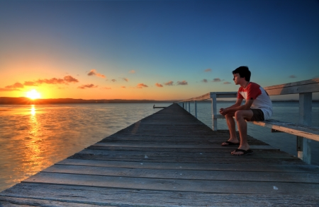 letting: Letting go of all lifes stresses and tensions, sitting quietly and watching the sunset  A peaceful soul makes life more loveable