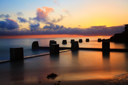 sun lit: Spectacular sunrise at the Coogee Baths, south side, Coogee, Australia   The sun lit up the summer sky   Long exposure
