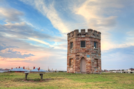 disused: Barack Tower was erected around 1820 where soldiers stood watch for smugglers and stray ships   It later became a customs tower and now is disused heritage building  located in a public park  Stock Photo