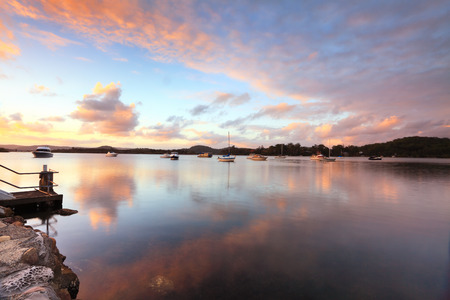 moorings: Sunset at Bensville Australia.   Boats and yachts and cloud reflections in the late afternoon.
