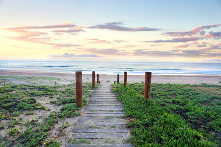 narrow:  Pretty sunrise and narrow path leading down to a glorious beach, The Entrance NSW Australia