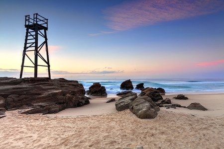 The Shark Tower and jagged rocks at Redhead Beach, NSW Australia photo
