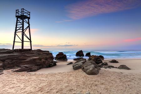 The Shark Tower and jagged rocks at Redhead Beach, NSW Australia photo