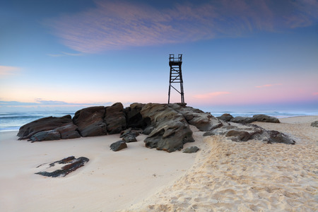Redhead Beach, a coastal suburb of Lake Macquarie, NSW, Australia  with shark tower just before sunrise, pretty pastels