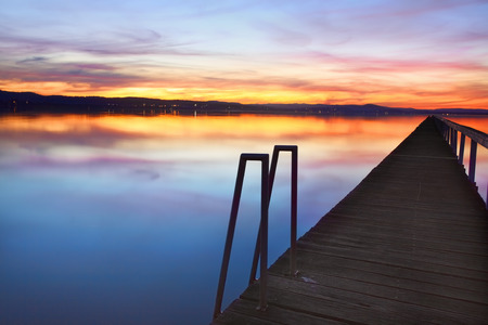 long lake: Sundown colours of the sky and water reflections at Long Jetty, Tuggerah Lakes NSW Australia Stock Photo