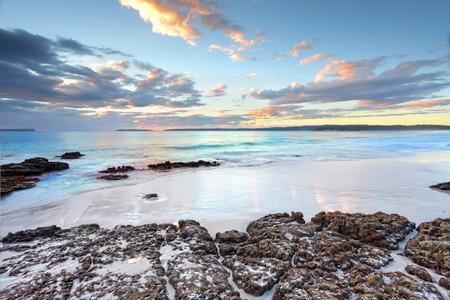 nsw: Dawn skies and ocean beach Jervis Bay NSW Australia Stock Photo