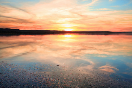 waterscape: Magnificent sunset and water reflections at Long Jetty, NSW Australia