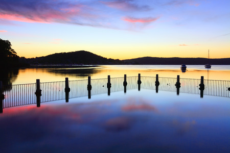 waters: Tranquil waters and colourful sunset reflections at Yattalunga NSW Australia  Stock Photo
