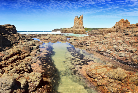 kiama: Cathedral Rock Kiama Downs Australia   There is motion in the fish swimming in the rock pool
