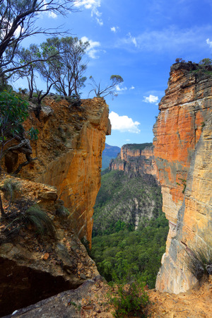 The magnificent sandstone vertical cliffs at Hanging Rock and Burramoko Head, Blue Mountains, NSW Australia   Please note, this is NOT the Hanging Rock in Victoria