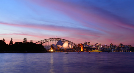 sydney harbour: Sunset over Sydney Harbour with Sydney Opera House and Sydney Harbour Bridge in view