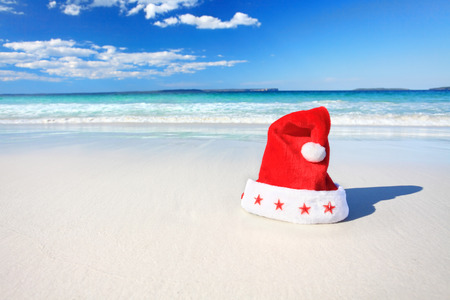 Christmas red Santa Hat on a sunny pristine beautiful beach in Australia photo