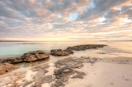 dappled: Pretty dappled skies over Scottish Rocks, Jervis Bay Australia at sunrise.