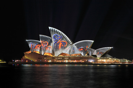 colourful images: SYDNEY, AUSTRALIA - JUNE 2, 2014; Sydney Opera House illuminated in colourful images during Vivid Sydney   This is sort of industrial pattern