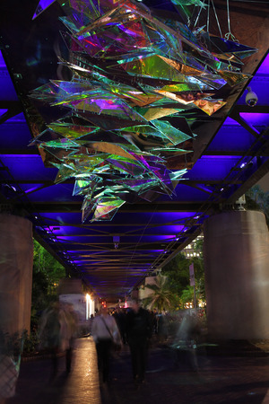 lull: SYDNEY, NSW, AUSTRALIA - JUNE 4, 2014;  People looking up while walking under Made You Look during Vivid Sydney   Using mirrors and projected images, this installation is interesting and fluctuating  every swell and lull of pedestrian traffic changes it   Editorial