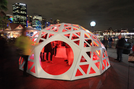 onlooker: SYDNEY NSW, AUSTRALIA - JUNE 4, 2014;   People interacting and observing the Geodesic Light Dome  Circular Quay Sydney during Vivid Sydney Festival of Light Music and Ideas   Strips of lightl form waves of colour and light  encapsulating the viewer in a m