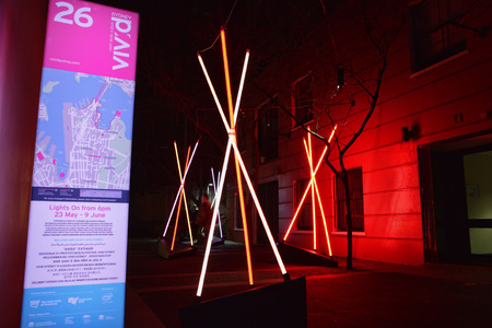 programmed: THE ROCKS, SYDNEY, AUSTRALIA - JUNE 6, 2014; Venture at Vivid Sydney, teepee structures in an alley, memories of childhood tents, where you used to play, hide, scheme and dream. Made of LED light tubes, programmed to flicker so that each pole is illumina Editorial
