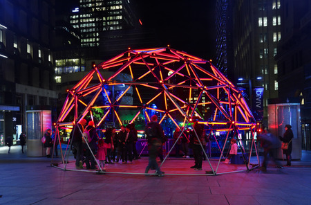 colour intensity: MARTIN PLACE, SYDNEY, AUSTRALIA - JUNE 6, 2014; Public and tourists interacting with Geo Glow Dome   It is a geodesic, pixel-mapped light sculpture that you can control, letting you design the colour, intensity and special effects of the lights that bring