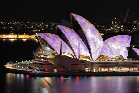 sydney harbour: YDNEY, NSW, AUSTRALIA - JUNE 6, 2014;  Iconic Sydney Opera House in vibrant colourful imagery during Vivid Sydney annual festival event  Editorial