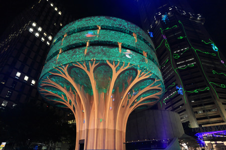 lifecycle: SYDNEY, NSW, AUSTRALIA - JUNE 6, 2014; A day in the life of a mighty forest tree - Vivid installation on Commercial Travellers Association building at Martin Place, by Urban Tree Project during Vivid Annual festival   Vivid is managed by the NSW Governmen Editorial