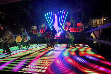 dance floor: SYDNEY, AUSTRALIA - JUNE 2, 2014;  Vivid Sydney Festival,families enjoy the Strictly Sydney interactive disco dance floor.  Image has grain