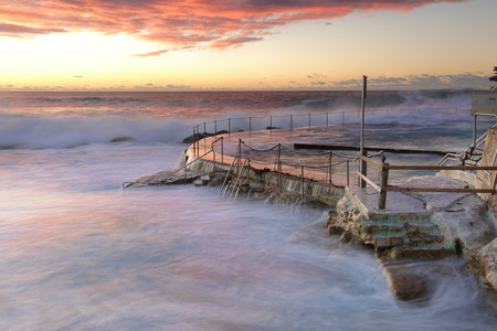 swell: Large swell and surf crashing over the railings, no swimming at Bronte Beach baths today Stock Photo