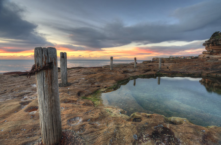 nsw: Sunrise and natural rock pool, South Coogee, East Sydney NSW, Australia  Stock Photo
