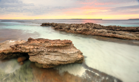 south coast: Pastel colours of a surreal sunrise at Hyams Beach at Jervis Bay, Australia.  Long exposure Stock Photo