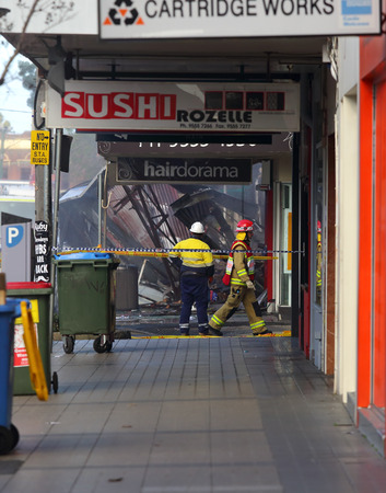 convenience store: ROZELLE, AUSTRALIA - SEPTEMBER 4, 2014;   Fire search and rescue teams begin the search in the remains of rubble for three missing people after an exposion in a convenience store in Darling Street, Rozelle, Sydney, Australia.  Police are treating the expl