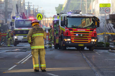 explosion engine: ROZELLE, AUSTRALIA - SEPTEMBER 4, 2014; Firefighters and rescue crew attend a shop explosion in Rozelle.   The main street blocked from traffic and public