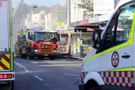 ambulance: ROZELLE, AUSTRALIA - SEPTEMBER 4, 2014;   Fire search and rescue teams and ambulance crew attend the shop blast tragedy in Darling Street, Rozelle.