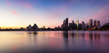 Sydney city skyline of office buildings and skyscrapers and Opera House along Sydney Harbour in the morning at sunrise